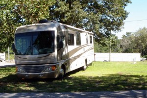 RV auto boat and other vehicle storage behind secure locked gates.